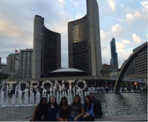 Posing in front of the Toronto sign