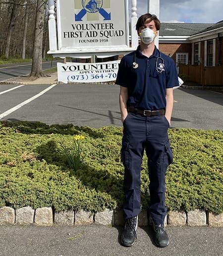 Tyler Cross near EMT squad sign