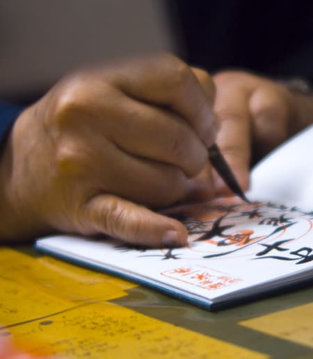 Hand drawing asian characters in a notebook