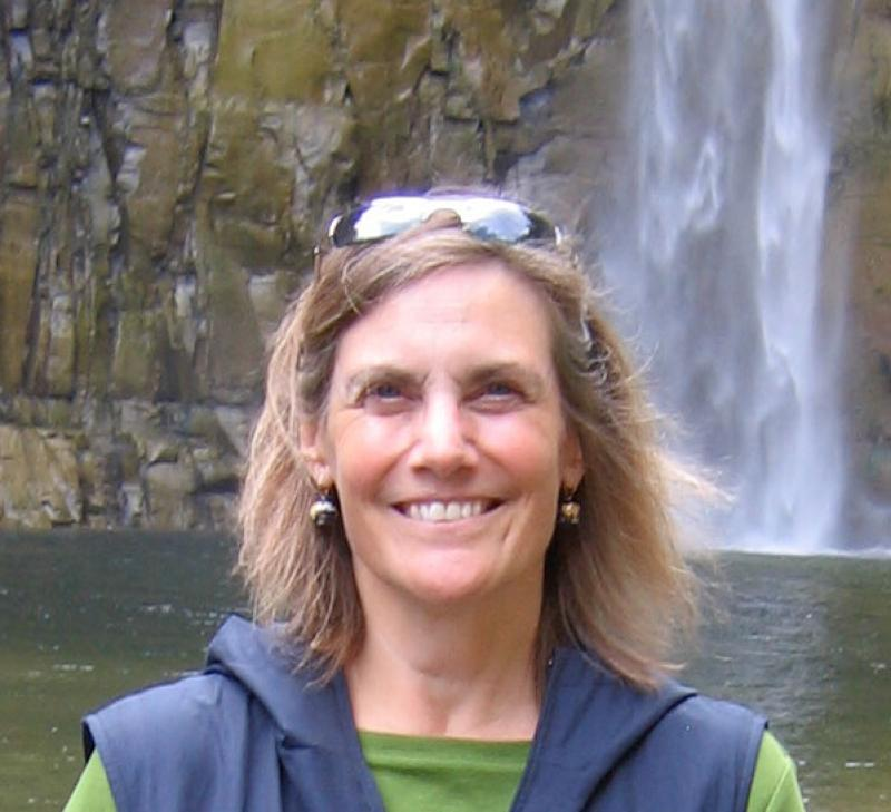 Nancy Green in front of a waterfall.
