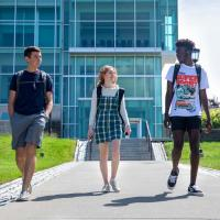 Three students in the Pre-Freshman Summer Program near the Physical Science Building.