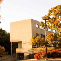 Malott Hall with surrounding trees in orange and yellow Fall colors