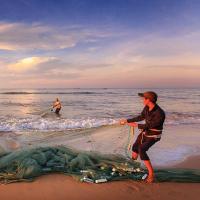 Man fishing with net