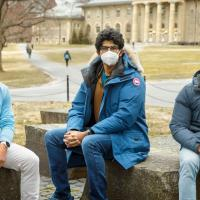 Three students on the Arts Quad