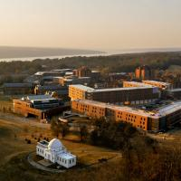 Campus buildings seen from above, in evening light