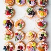 Donuts decorated with fruit and flowers