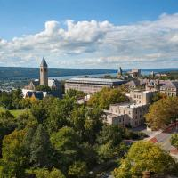 View of Cornell campus from above; under a blue sky