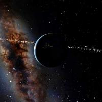 A planet with stars and a dark sky in the background