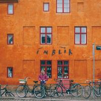Orange building with bicycles parked in front