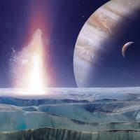 Artist's rendition of an exoplanet with an ocean on another world in front of it