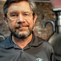 Steve Hindy in front of brewing equipment