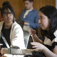 Two women students talking