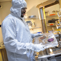 A man wearing protective gear in a lab