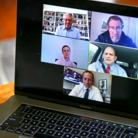 Computer showing five people