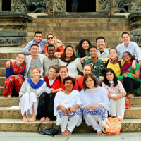 Group of people seated on stone steps