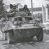 Tank on city street, black and white image