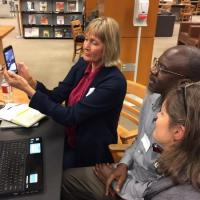 Faculty learning how to use a smartphone to share infrmation