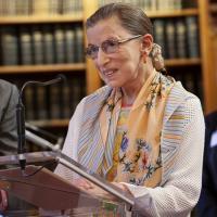 Ruth Bader Ginsburg, speaking at a podium