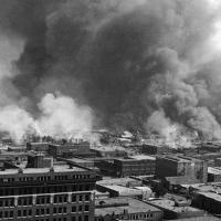 Historic photo: Smoke billows beyond city buildings