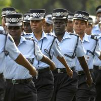 Royal Solomon Islands Police Force female officers march down the main street of Honiara on International Women's Day, 8 March 2010