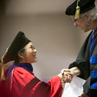 Woman receiving Ph.D.