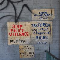Wall paintings saying 'stop police violence'