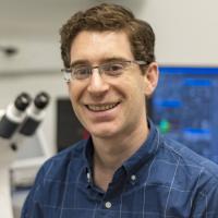 Jeremy Baskin with lab in background