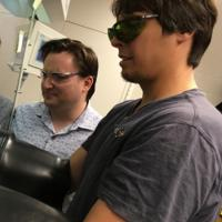 Kyle Lancaster with student in lab