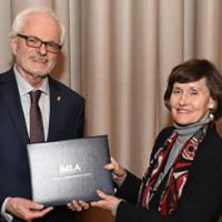 MLA President Anne Ruggles Gere presenting award to William Kennedy. Photo credit: Edward Savaria, Jr
