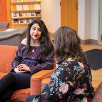 Kamla Arshad, left, and Estefania Perez, center, talk with career counselor Ana Adinolfi.
