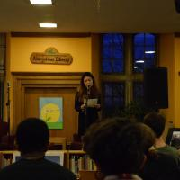 Student reads their poem at Radiant Voices