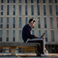 Student on computer infront of libary