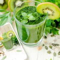 Glass of green juice, fruit