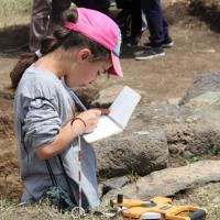 Camper Mary draws an excavation trench at Gegharot, an archaeological site in Armenia.