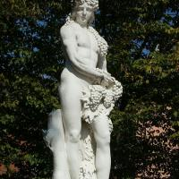 Statue of Bacchus holding bunches of grapes