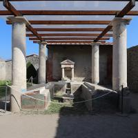 Garden triclinium (outdoor dining benches) at the Casa dell'Efebo, a wealthy house in Pompeii. Paintings of Egyptian landscapes decorate the sides of the benches where people once reclined to dine, and an artificial canal once flowed between the benches.
