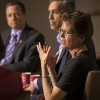 Dean Gretchen Ritter speaking on a panel of participants