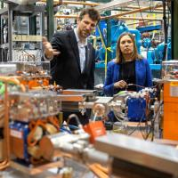 Georg Hoffstaetter, professor of physics, and Alicia Barton, president and CEO of the New York State Energy Research and Development Authority, tour the Cornell-Brookhaven ERL Test Accelerator facility.