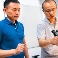 Xianwen Mao, left, and Peng Chen, the Peter J.W. Debye Professor of Chemistry, are pictured in the microscope room in Olin Research Laboratory.