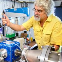 Richard Gillilan, MacCHESS staff scientist, loads a biological sample in preparation for X-rays
