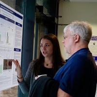 """Professor David Smith asks Rebecca Horotwitz about her independent research project (""""Neural correlates of aggression in prairie voles"""") in Professor Alex Ophir's lab."""