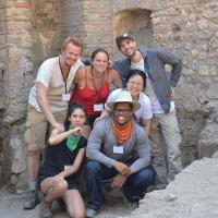 Six people in an ancient stone structure
