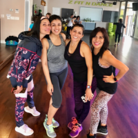 Smiling after an intense (and sweaty!) class with my Zumba mentors at my hometown studio.