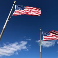 Two American flags on poles