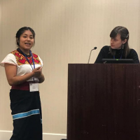 Carol-Rose Little and Morelia Vázquez Martínez presenting their research.