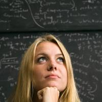 Student with math equations
