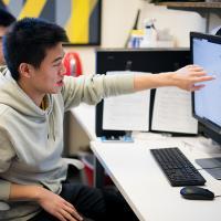 Students work in the Milstein Program offices in Rockefeller Hall.