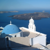 White Greek building against a blue sea: island of Santorini