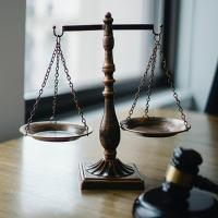 Scale and gavel on a desk