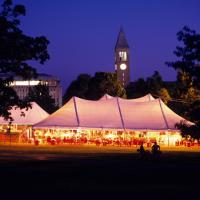 Big tent on the Arts Quad with lots of alumni
